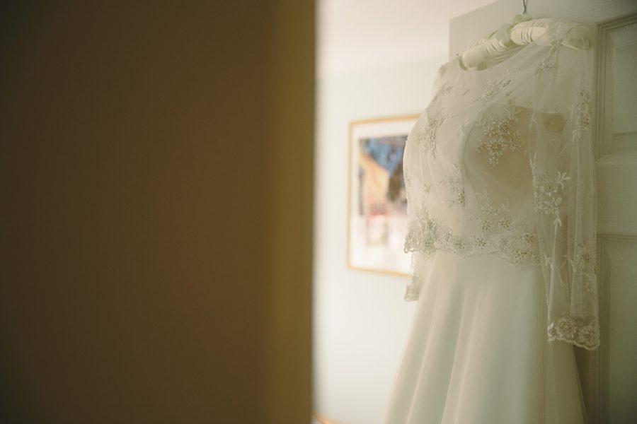 wedding dress at barnsley house wedding by sam gibson