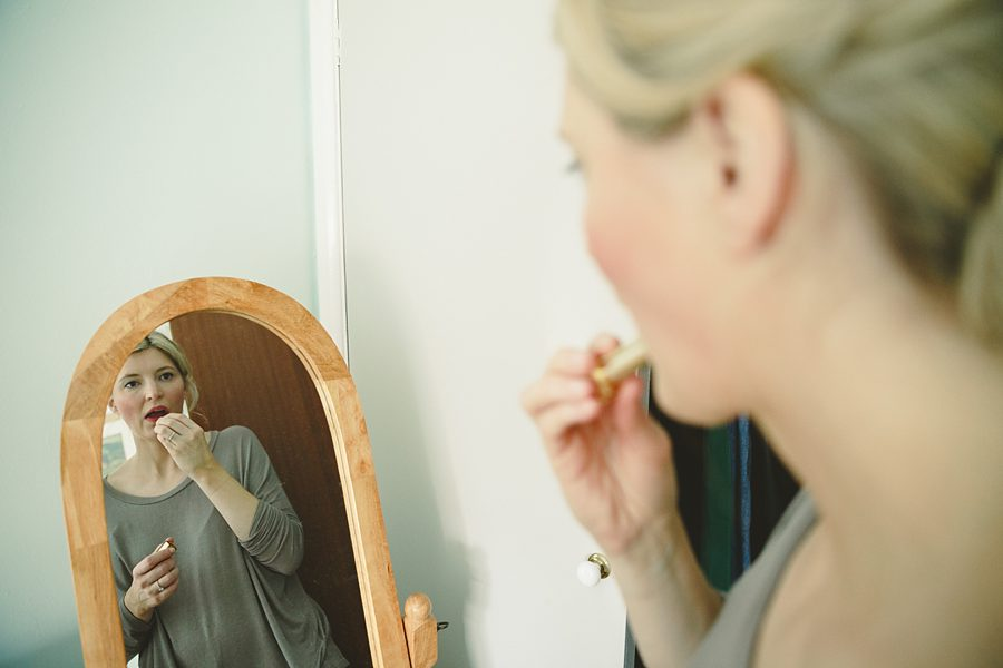 bride getting ready for a wedding in cirencester by sam gibson