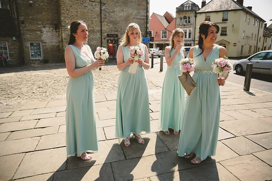 bridesmaids waiting for the bride in cirencester by sam gibson
