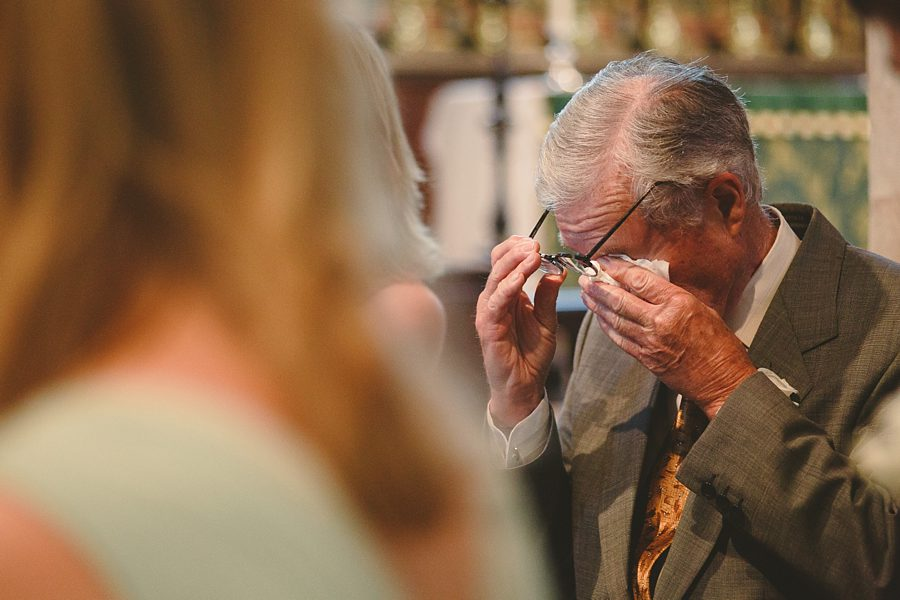 wedding guest crying at cirencester church by sam gibson