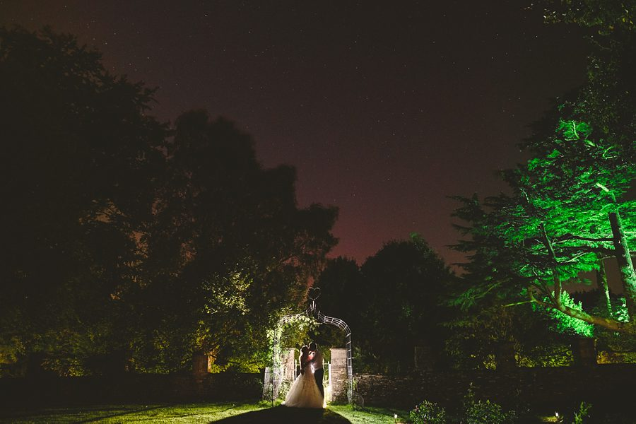 bride and groom portrait at the great tythe barn in tetbury by wedding photographer sam gibson