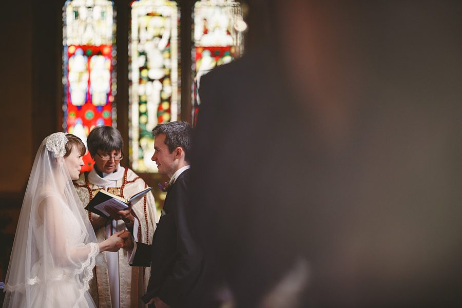 a photograph of a wedding at st mary the virgin church in lower westwood by sam gibson