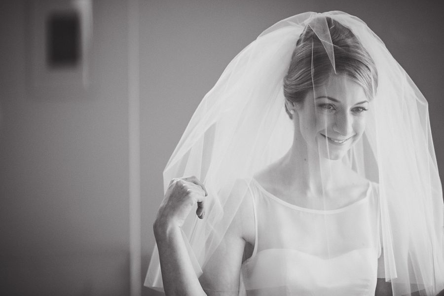 bride adjusting her veil at home
