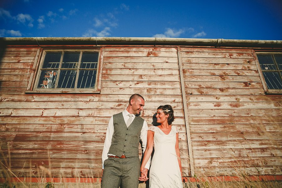 bride and groom at kingscote barn