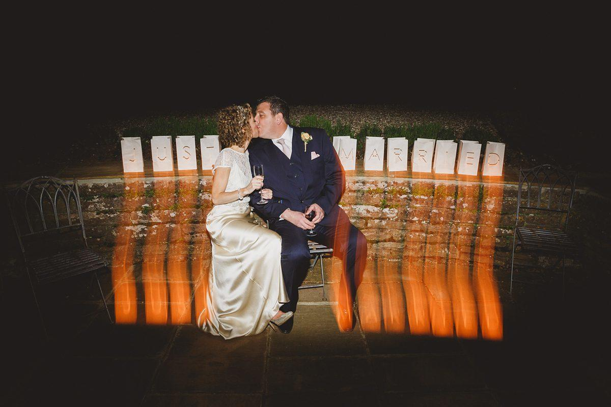 bride and groom kiss at coombe lodge