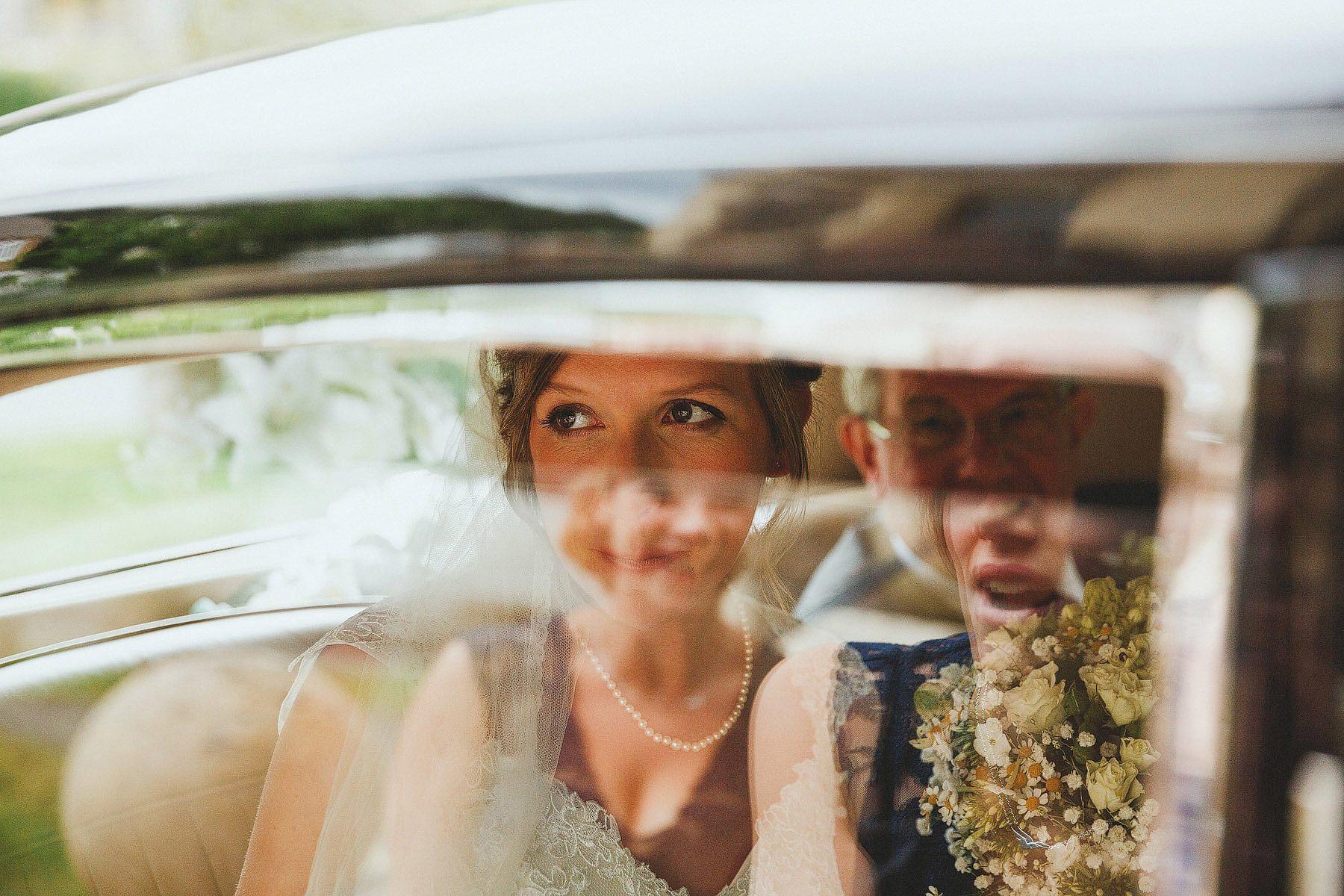 bride looking through car window in portishead