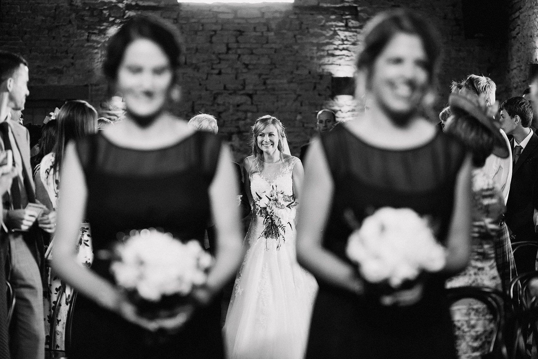 bride walking up the aisle cripps barn