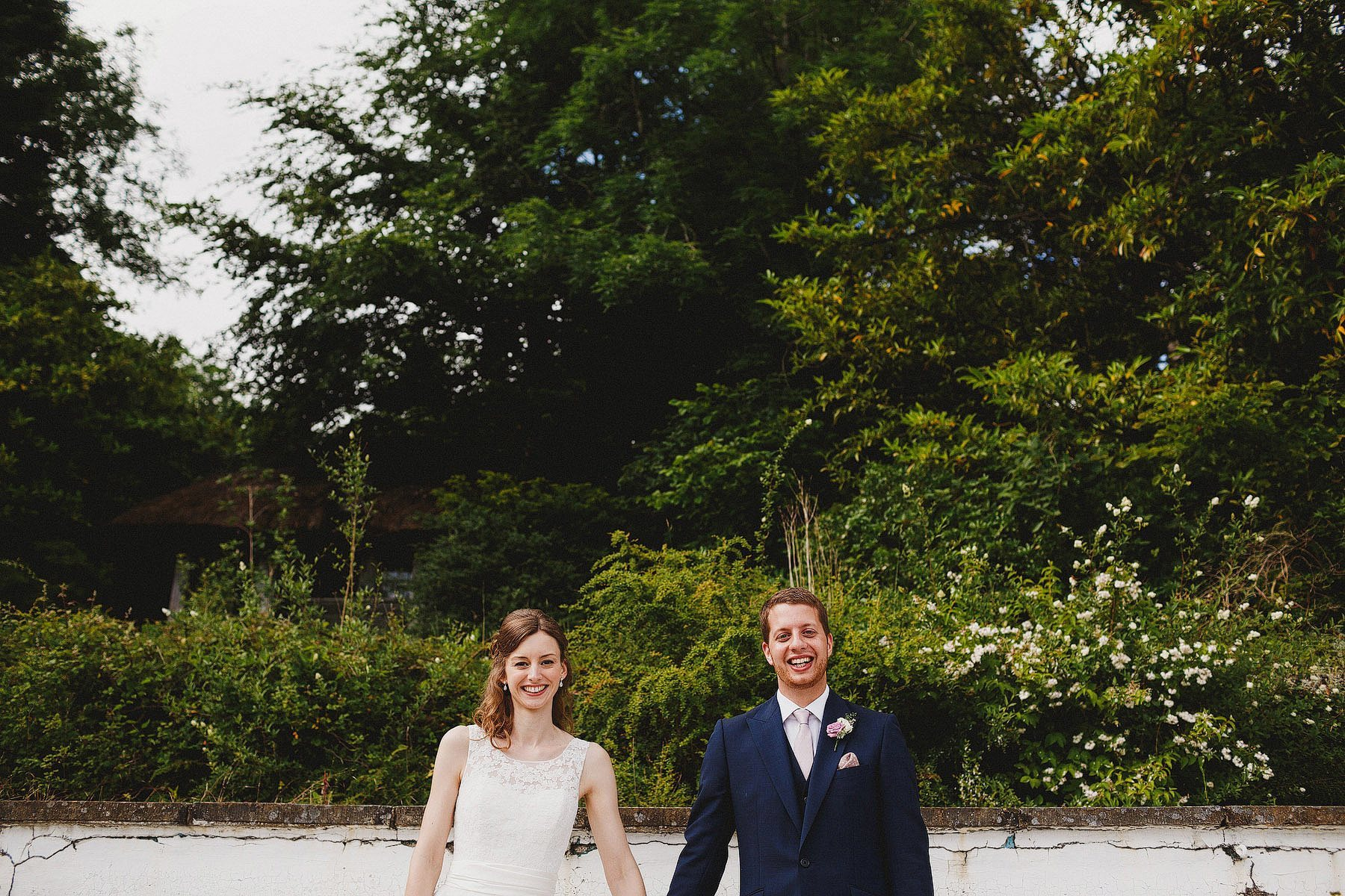 bride and groom disused swimming pool
