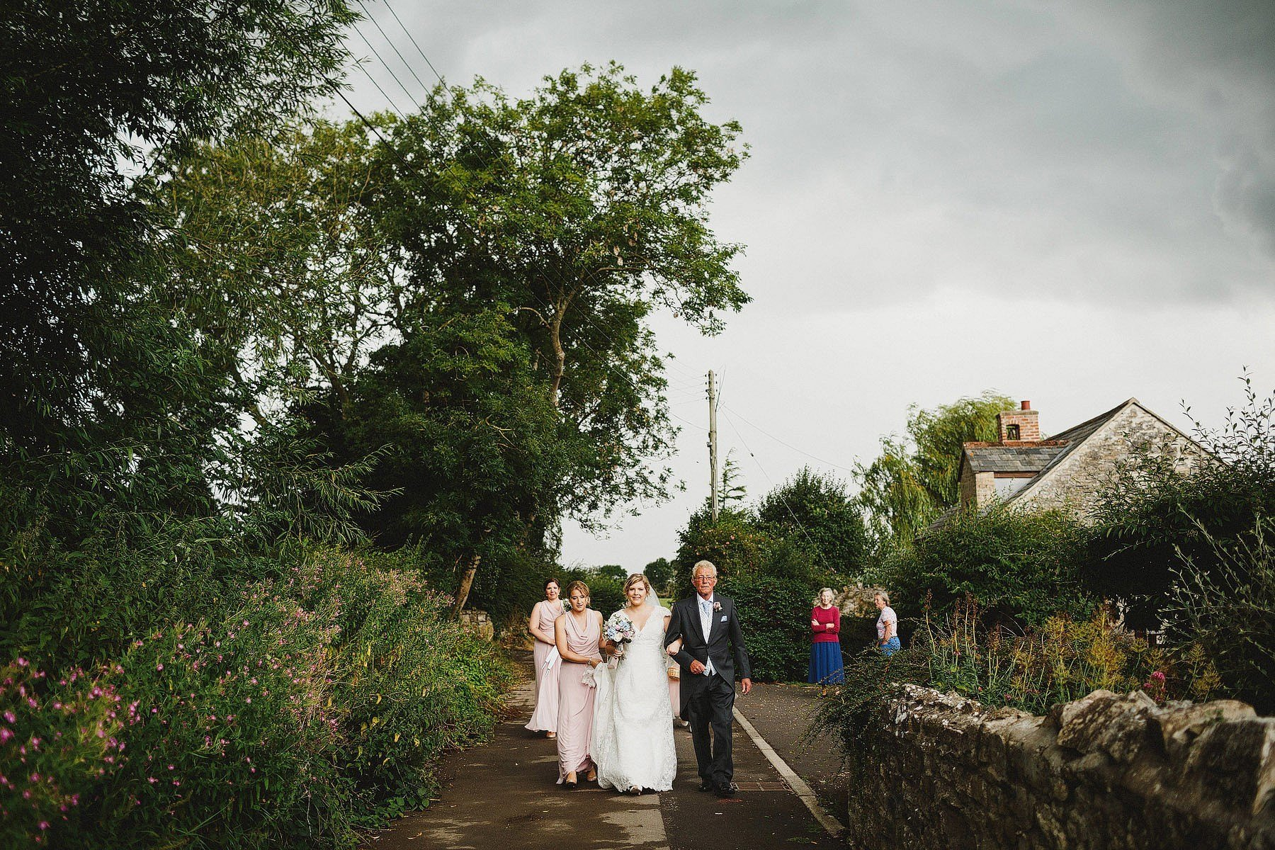 bride walking down road to the church