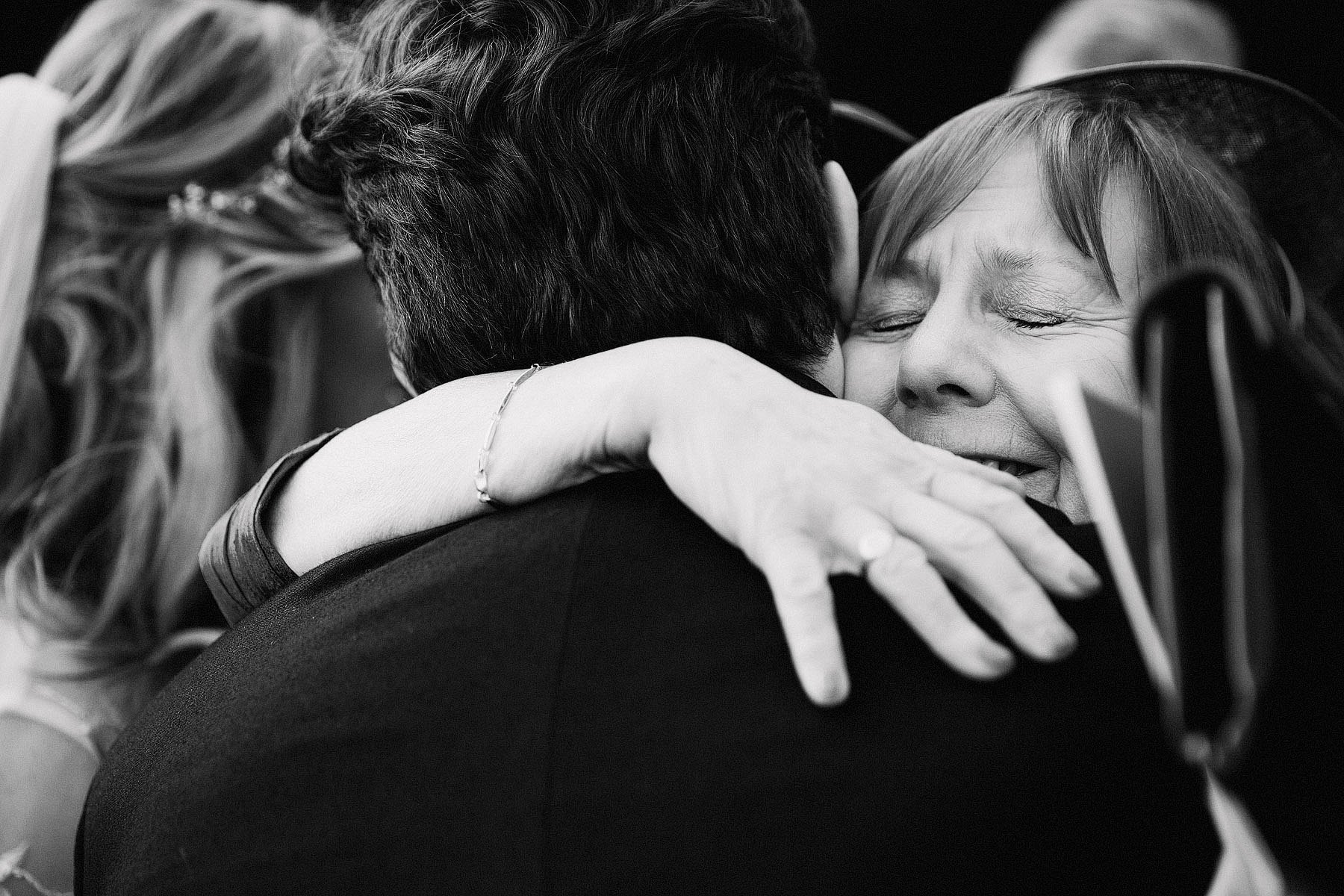 groom and mother hugging