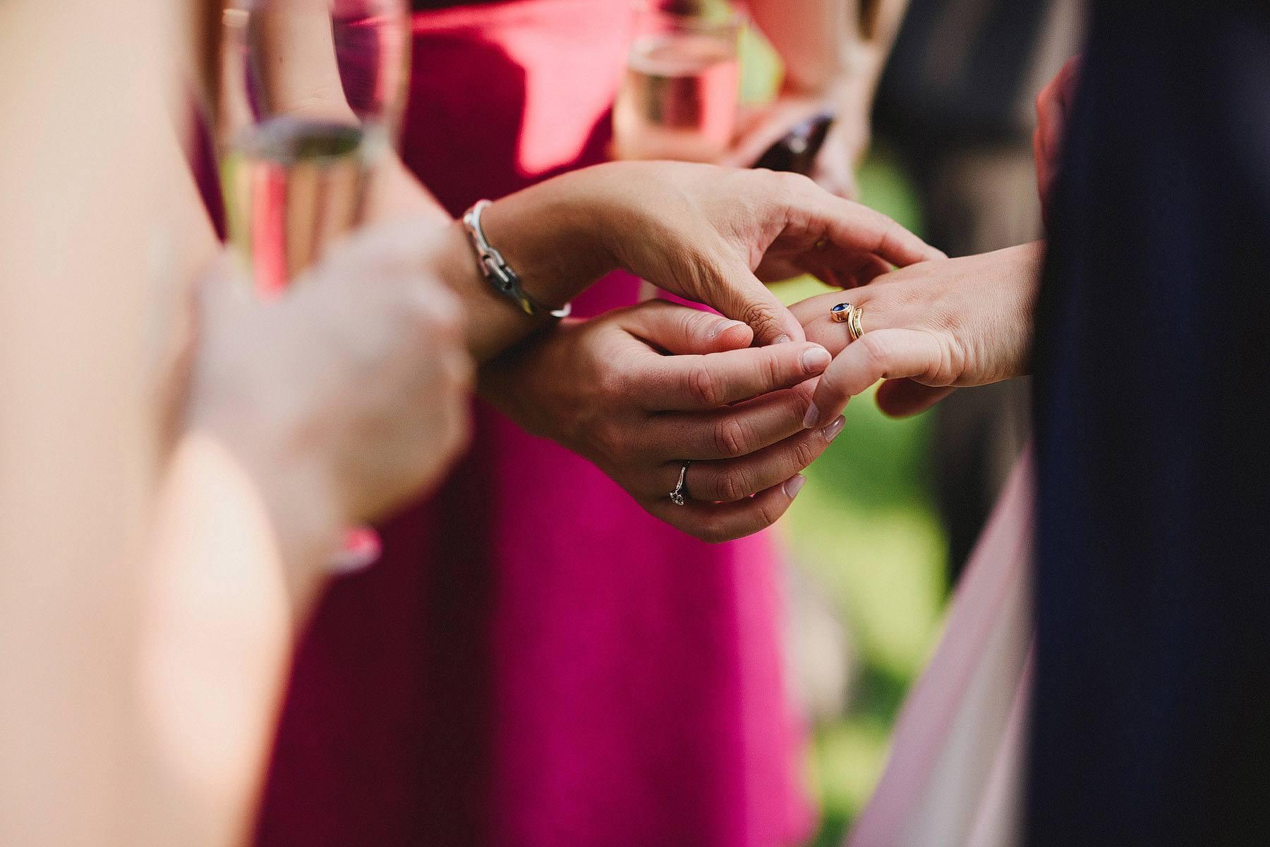 guests admiring wedding ring