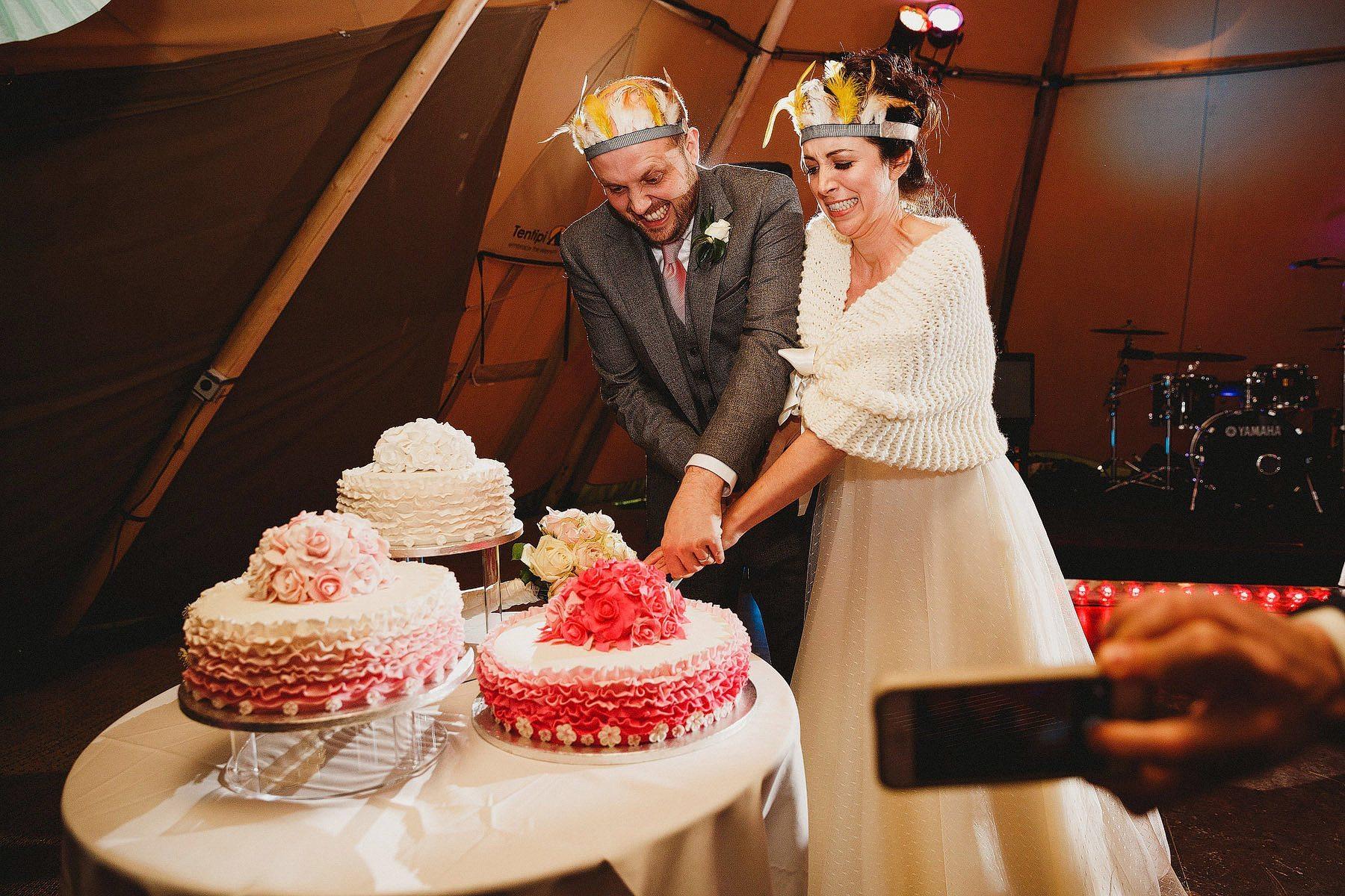 funny cake cut wedding photo