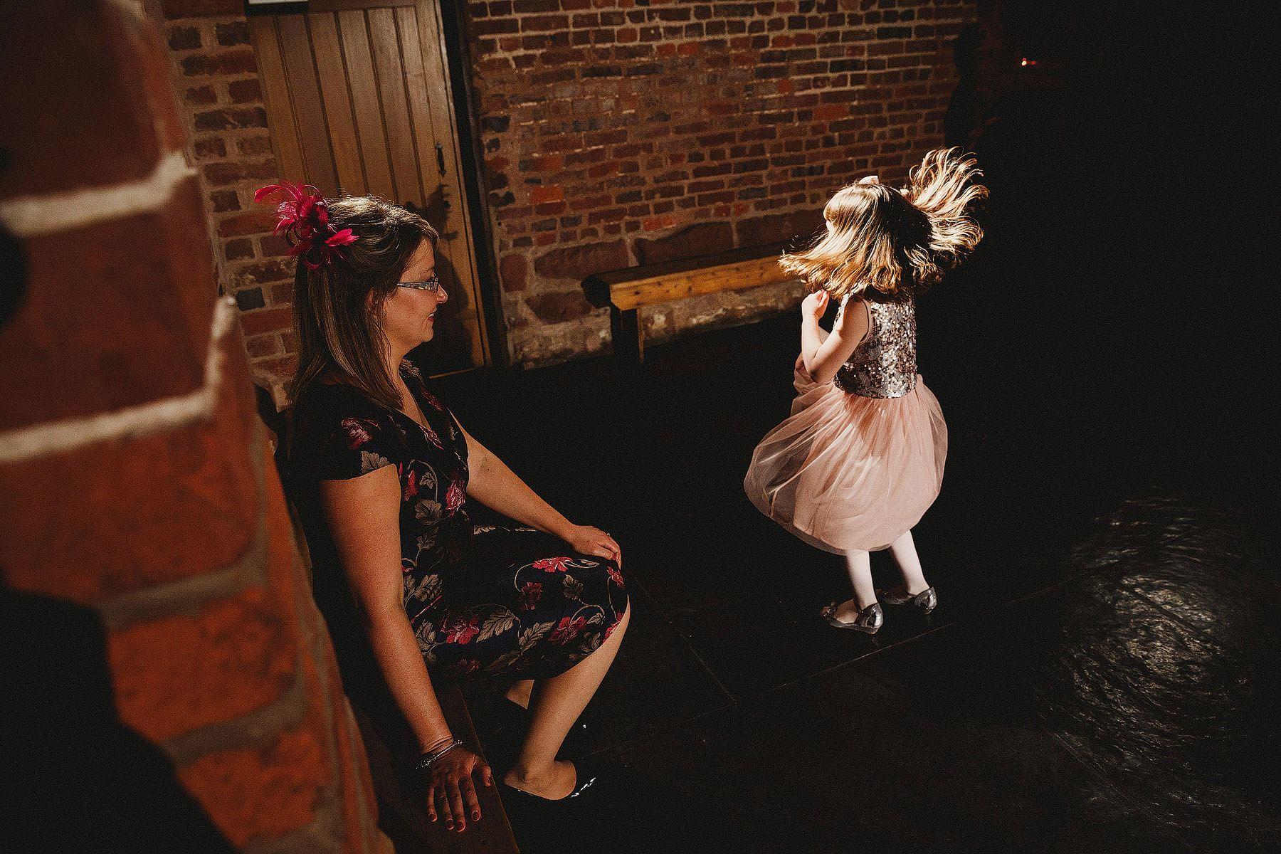 girl dancing at curradine barns wedding