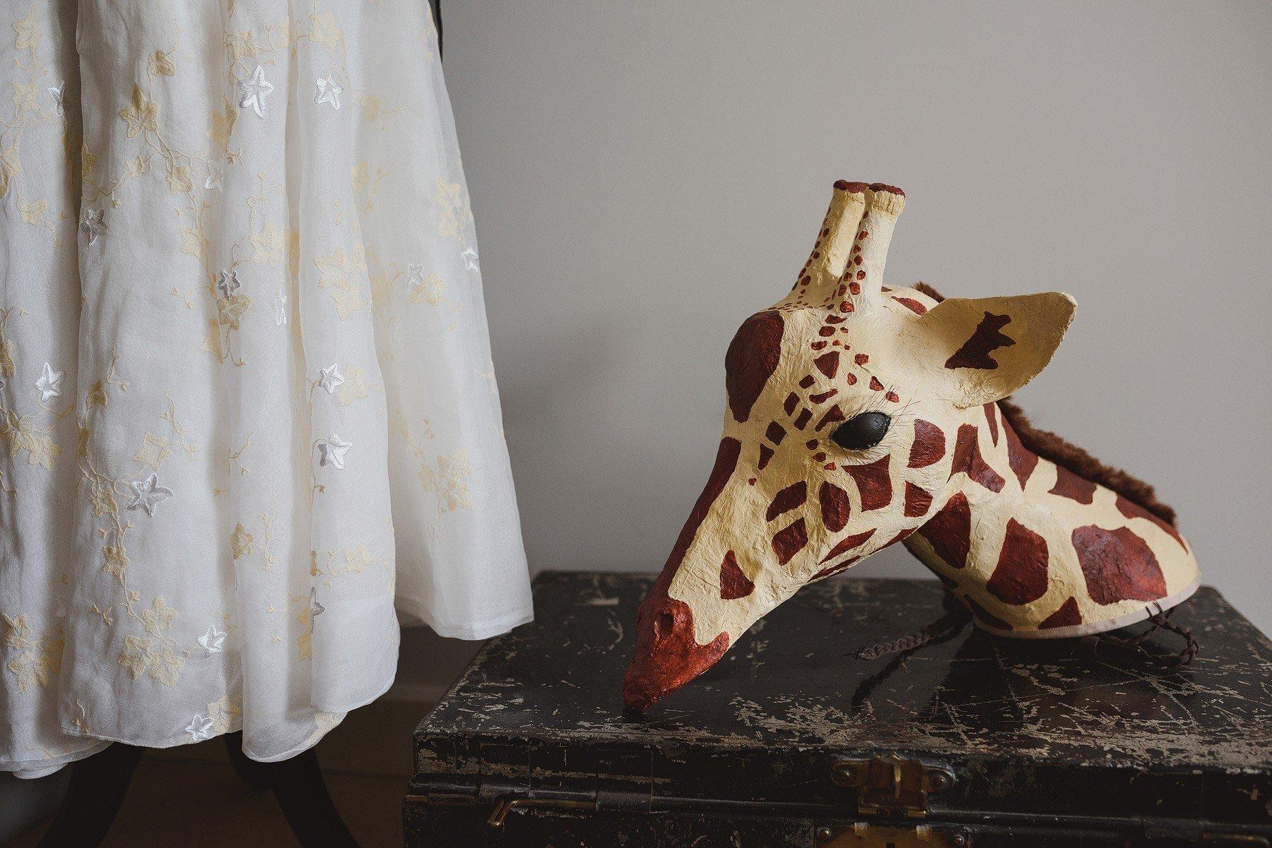 giraffe mask at a wedding