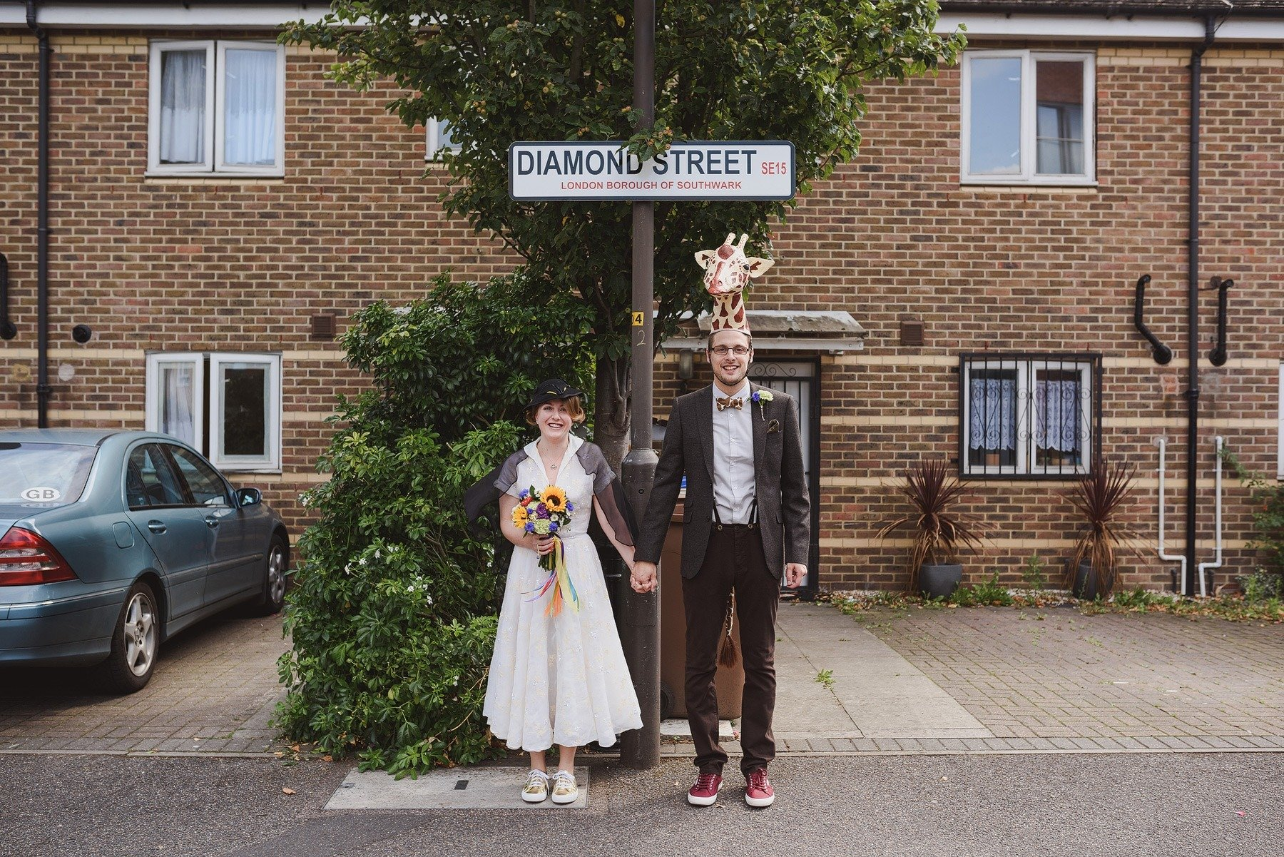 bride and groom dressed as a penguin and a giraffe