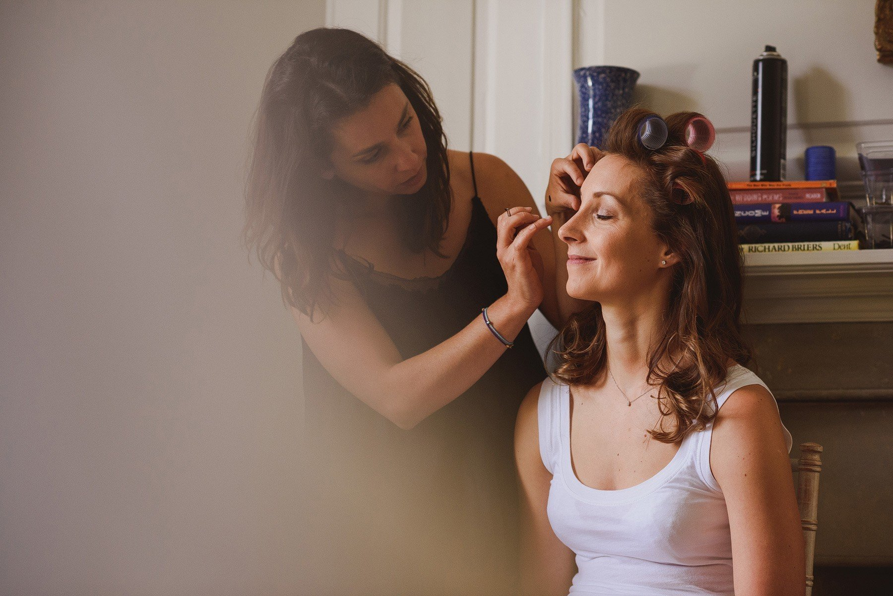 bride having her make up done at the rectory