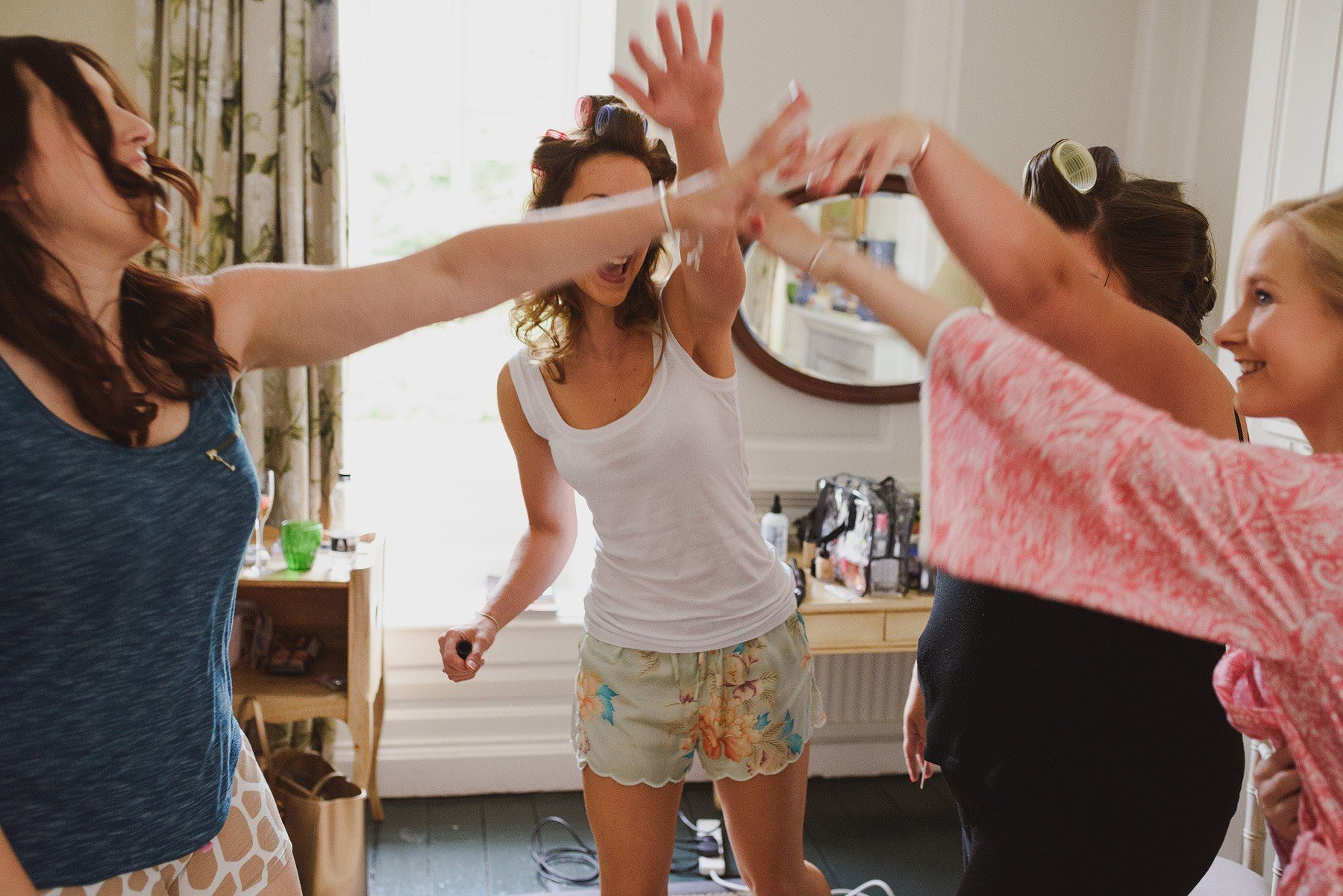 bride and bridesmaids cheer
