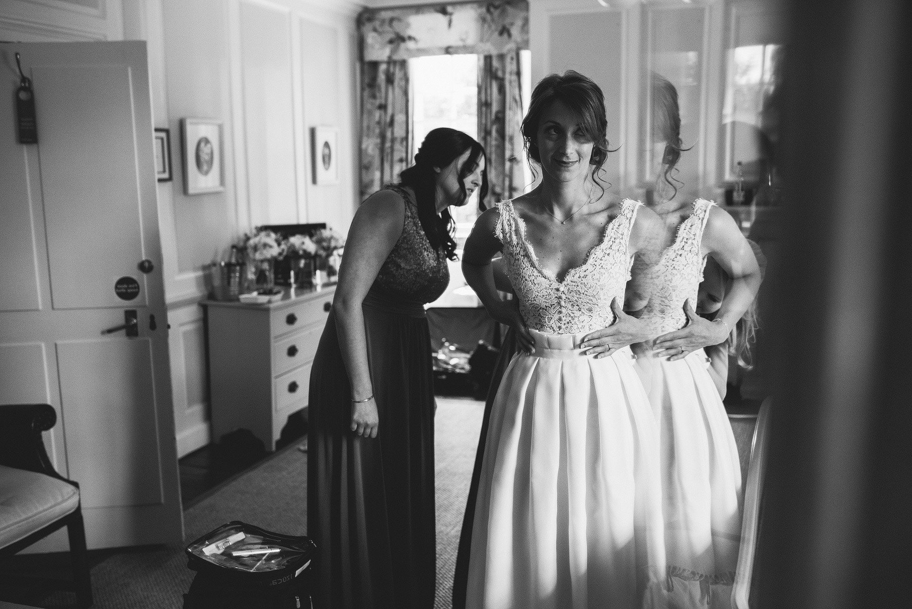 bride putting her dress on at the rectory
