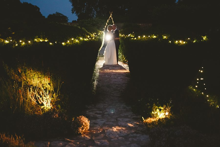 bride and groom portrait night at barnsley house by sam gibson