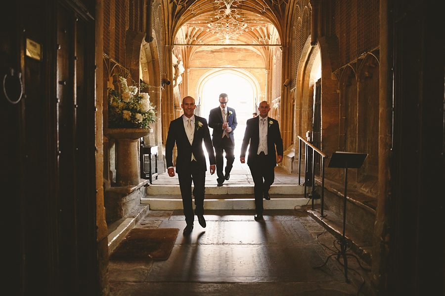 groom at church for a wedding in cirencester by sam gibson