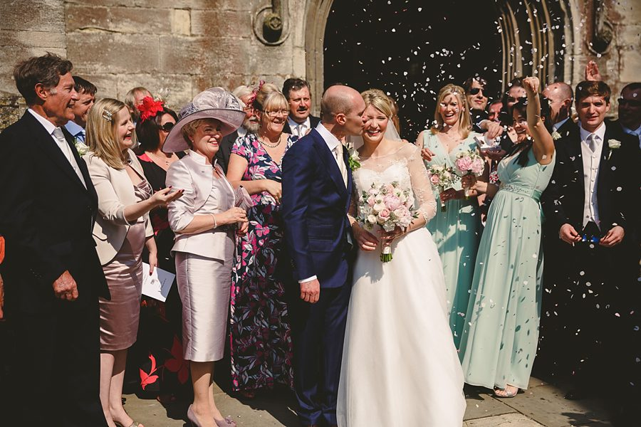 confetti outside cirencester church by sam gibson