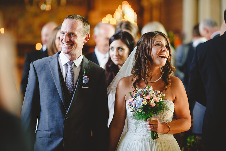 bride and groom walking down the aisle in north nibley church by sam gibson