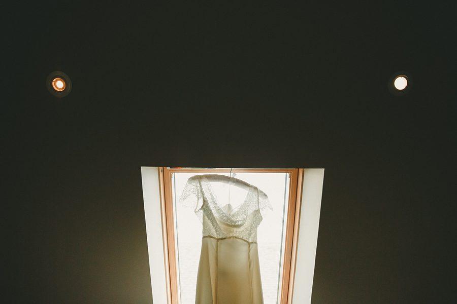 wedding dress hanging up at hyde barn