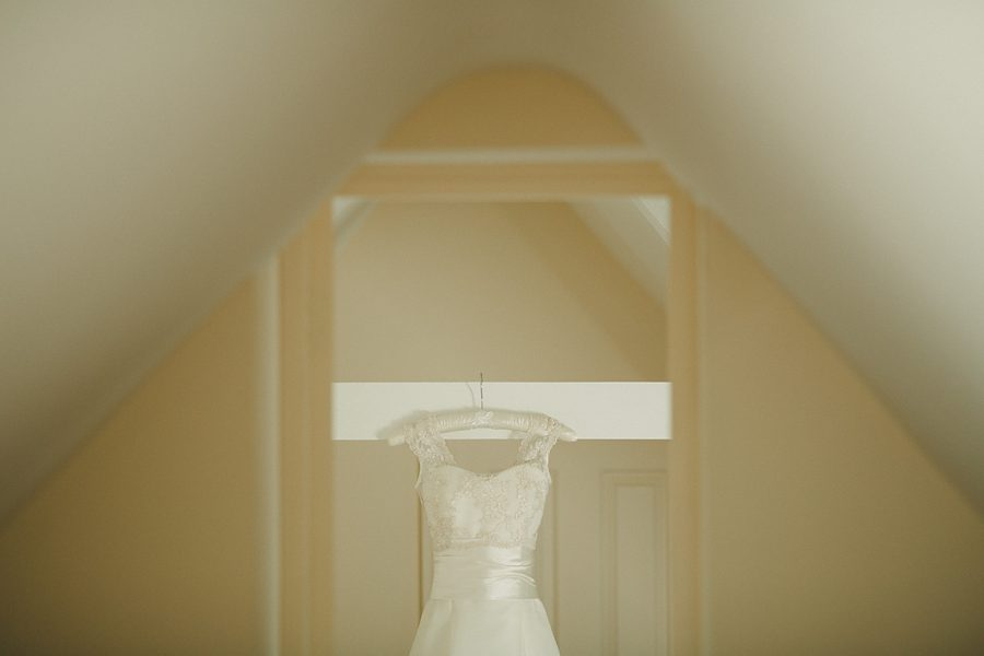 wedding dress hanging up at home