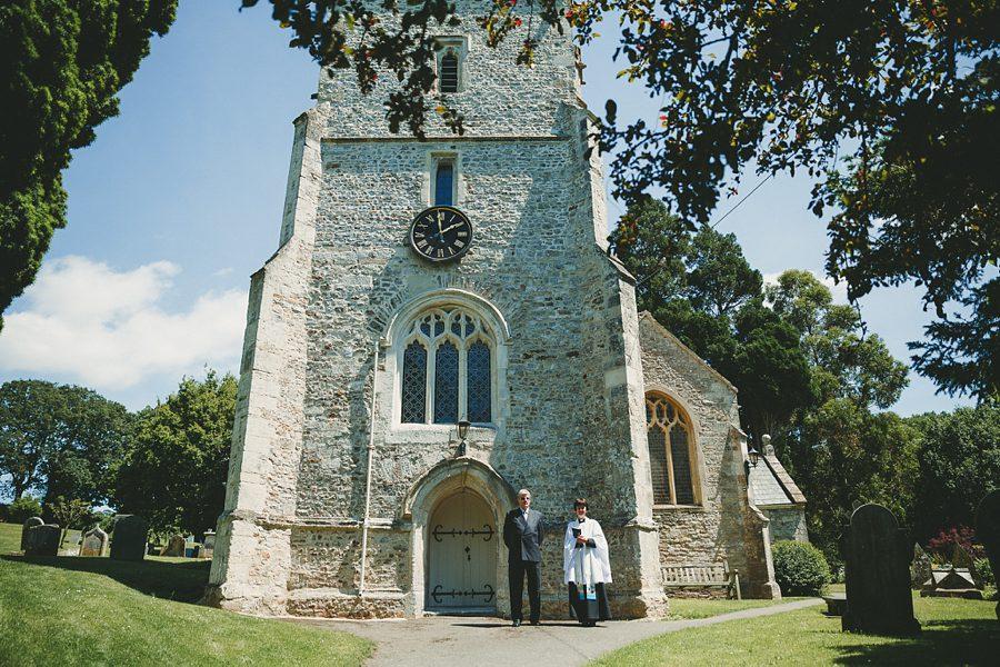 vicar waiting at the church door before a wedding
