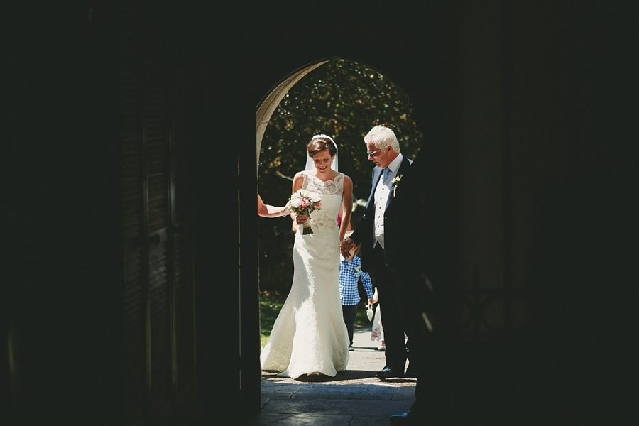 bride waiting at the church door before a wedding