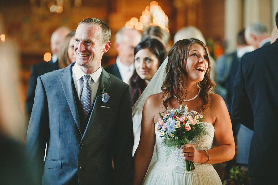 bride and groom leave kelmarsh hall wedding