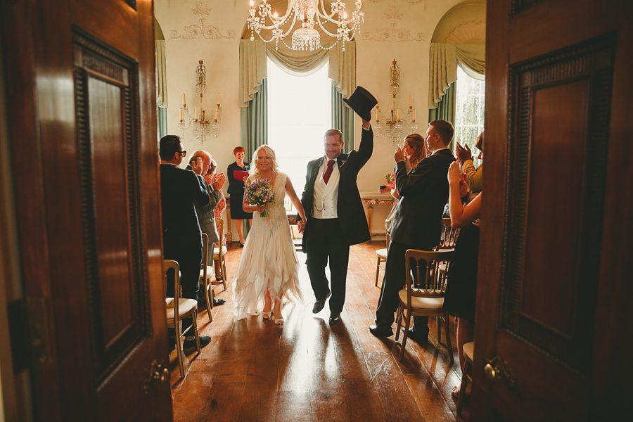 bride and groom leave devon church wedding