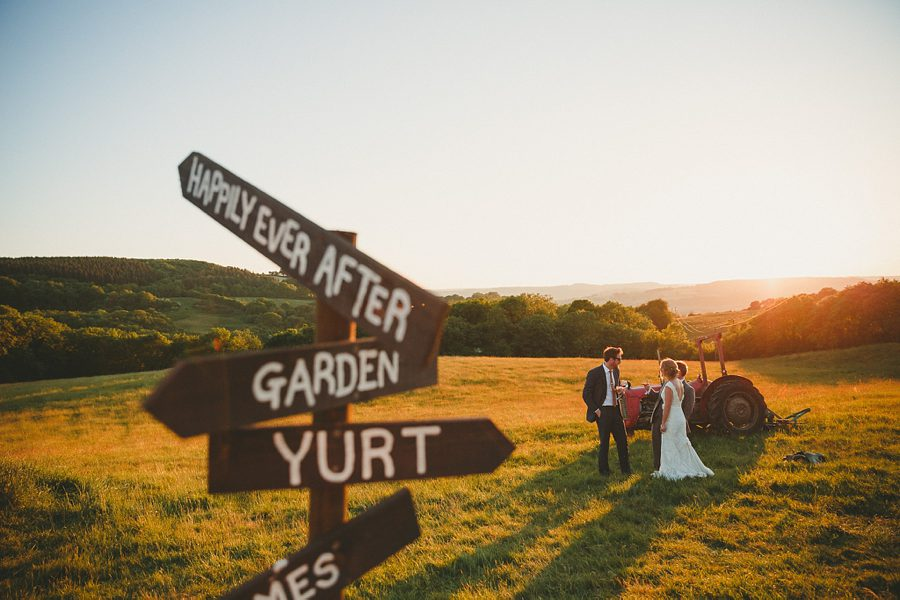 bride and groom walk through the gardens at the matara centre