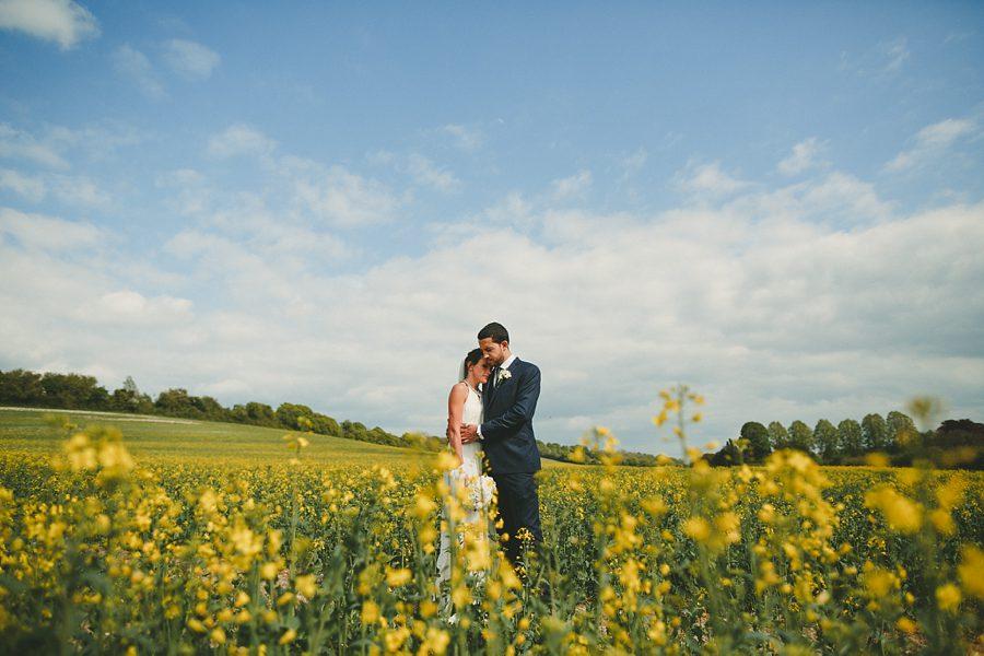 bride and groom portrait at lyme regis bay