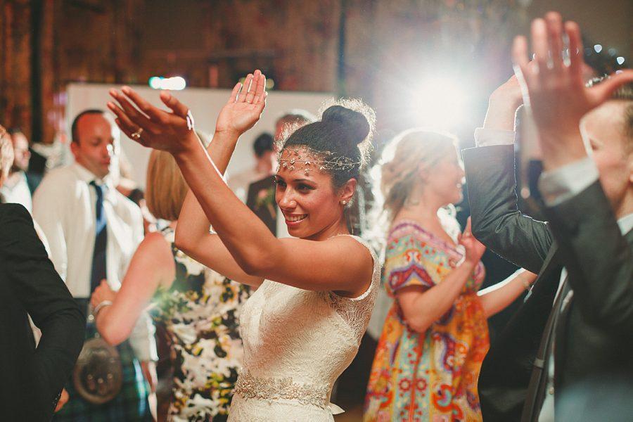 bride dancing at larmer tree gardens