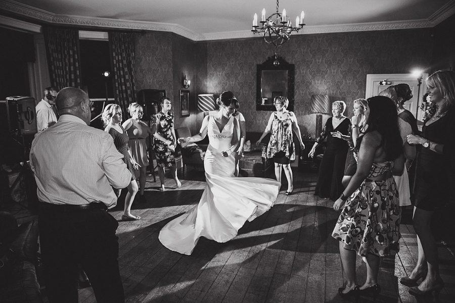 bride and bridesmaids dancing at hyde barn