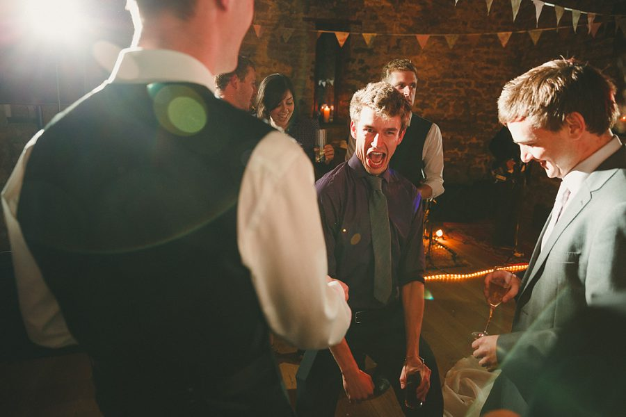 bride and groom hug on dancefloor at charlton house wedding