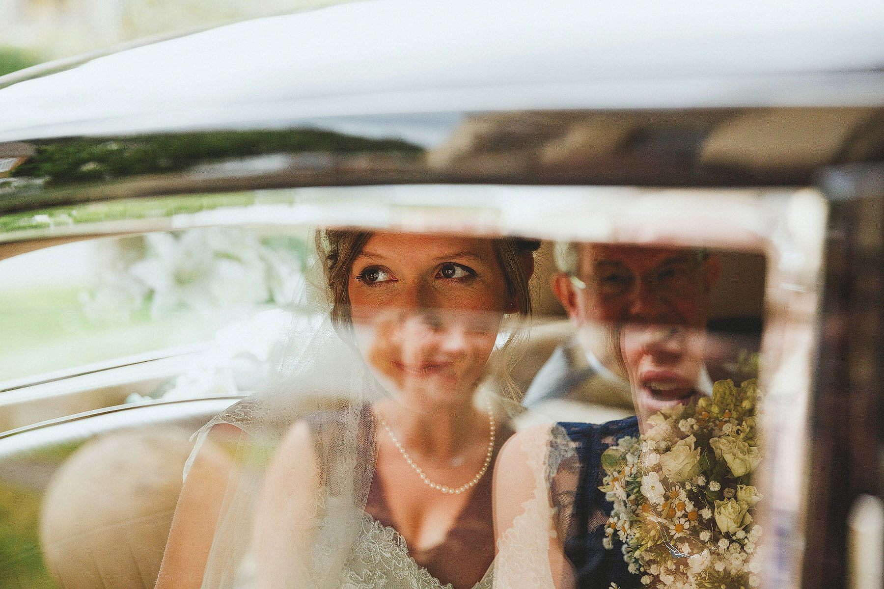 bride looking through car window in portishead