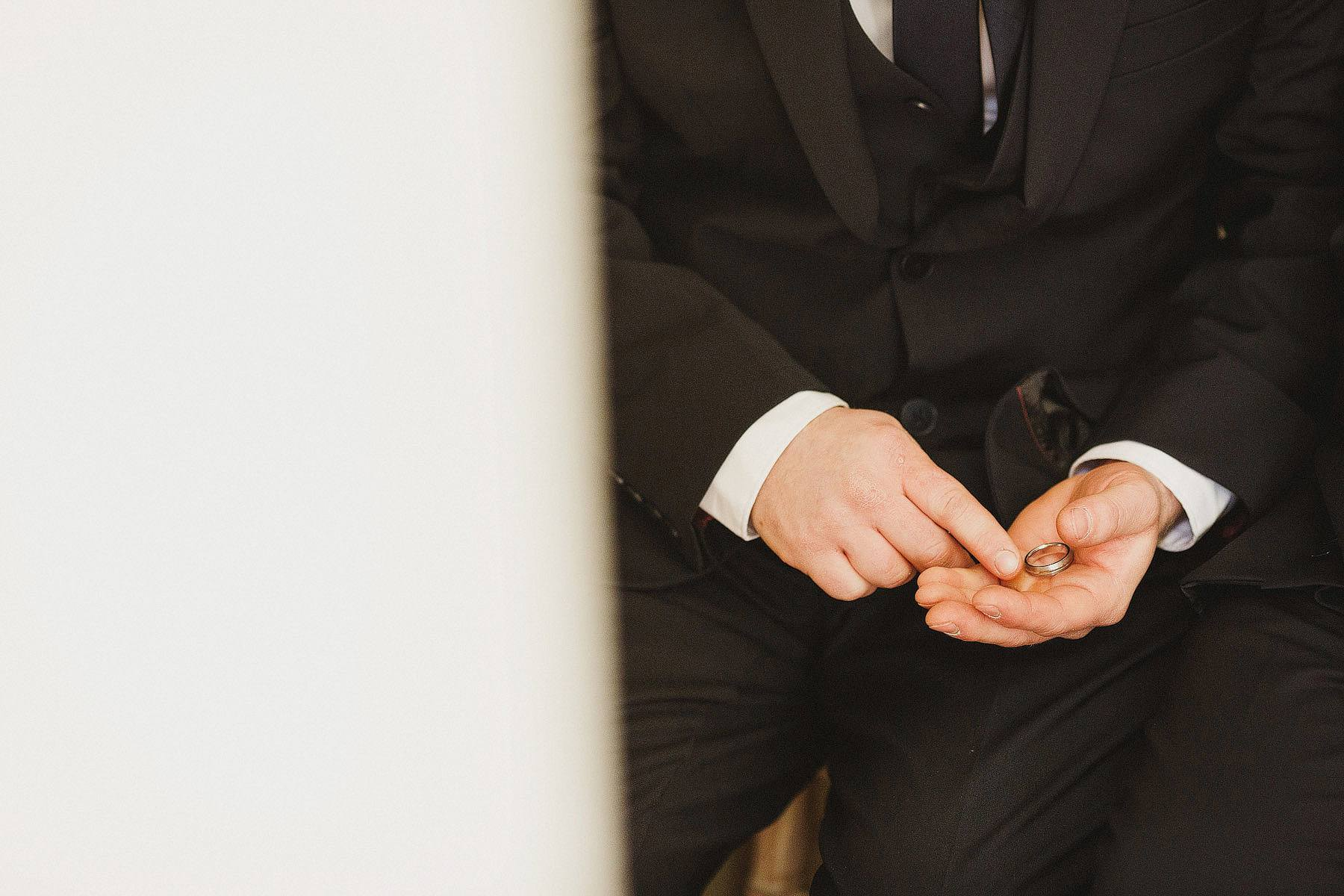 best man holding ring