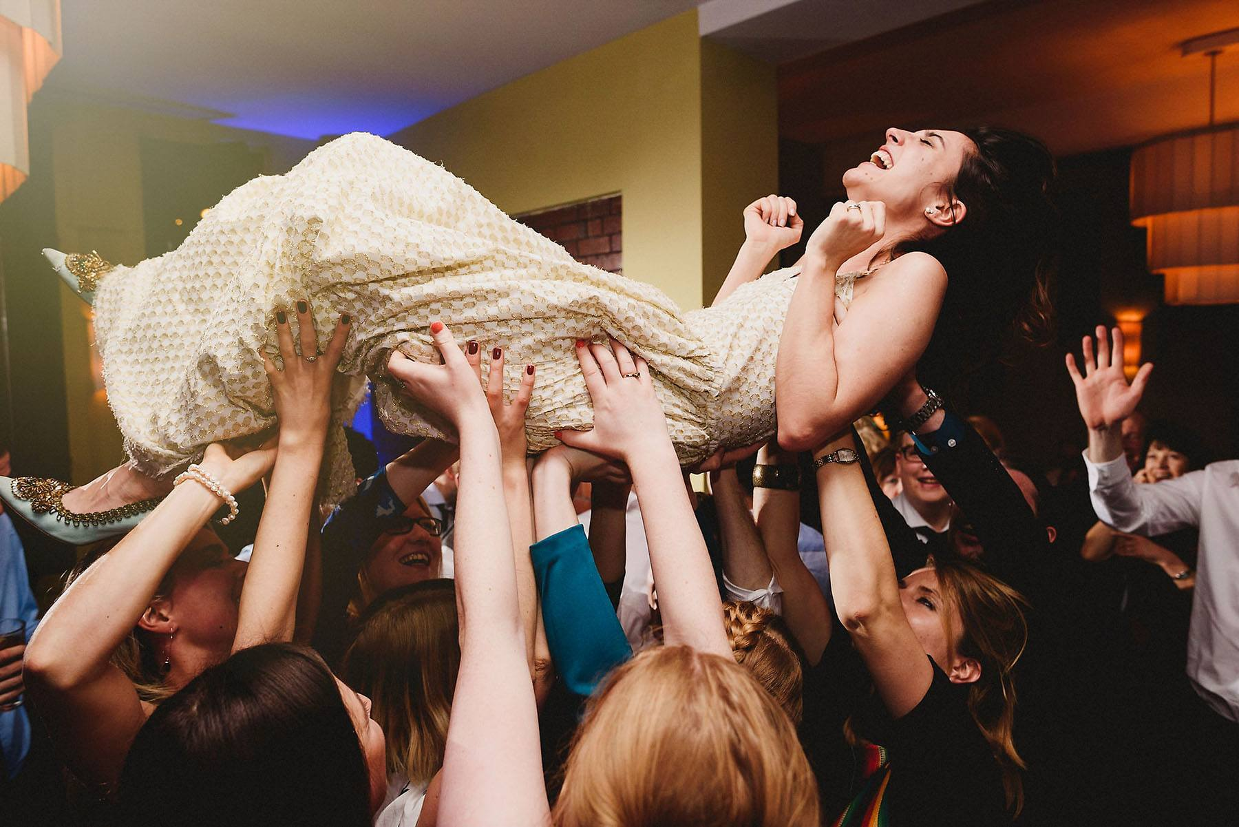 bride crowdsurfing goldbrick house