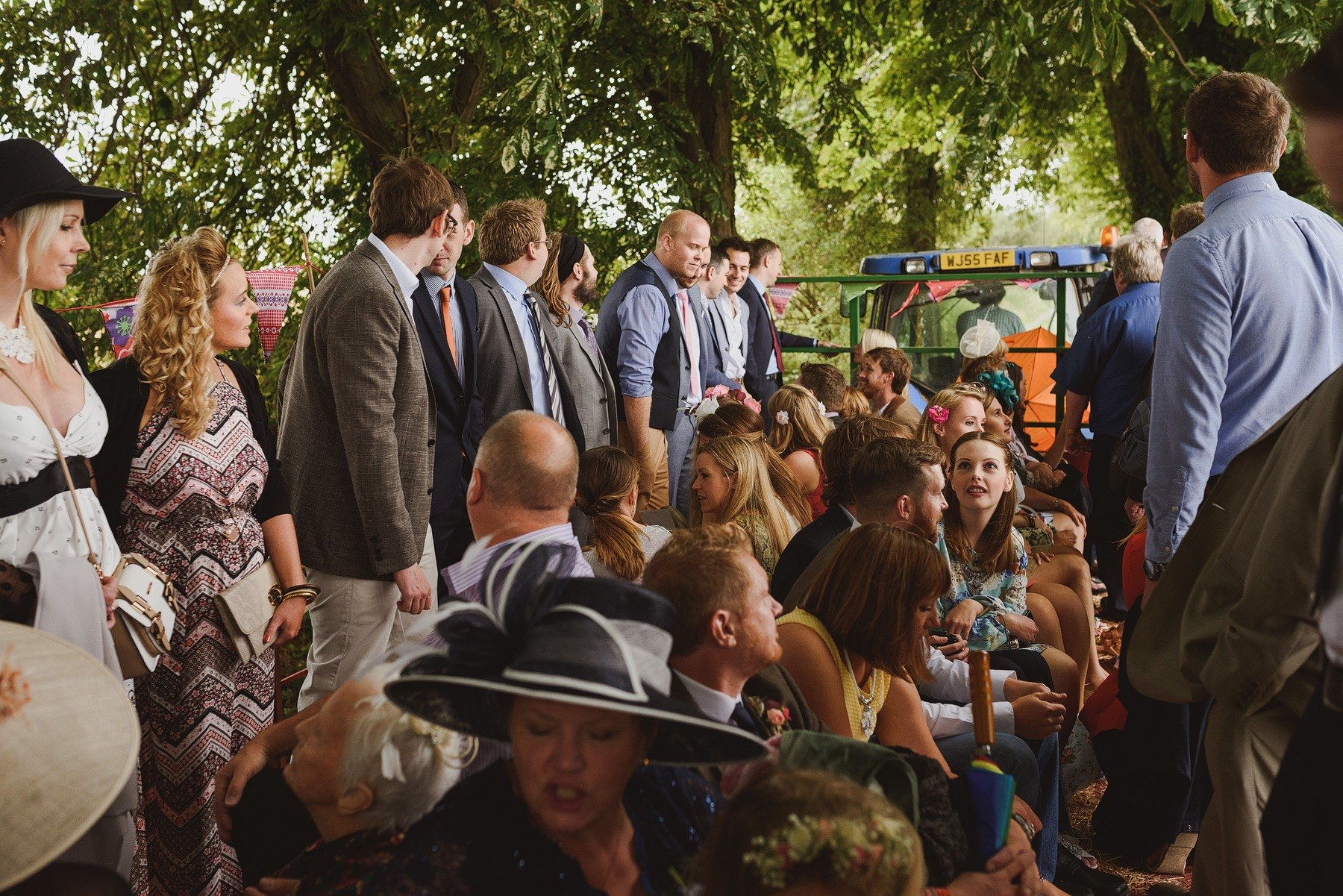 wedding guests on the tractor at huntstile farm