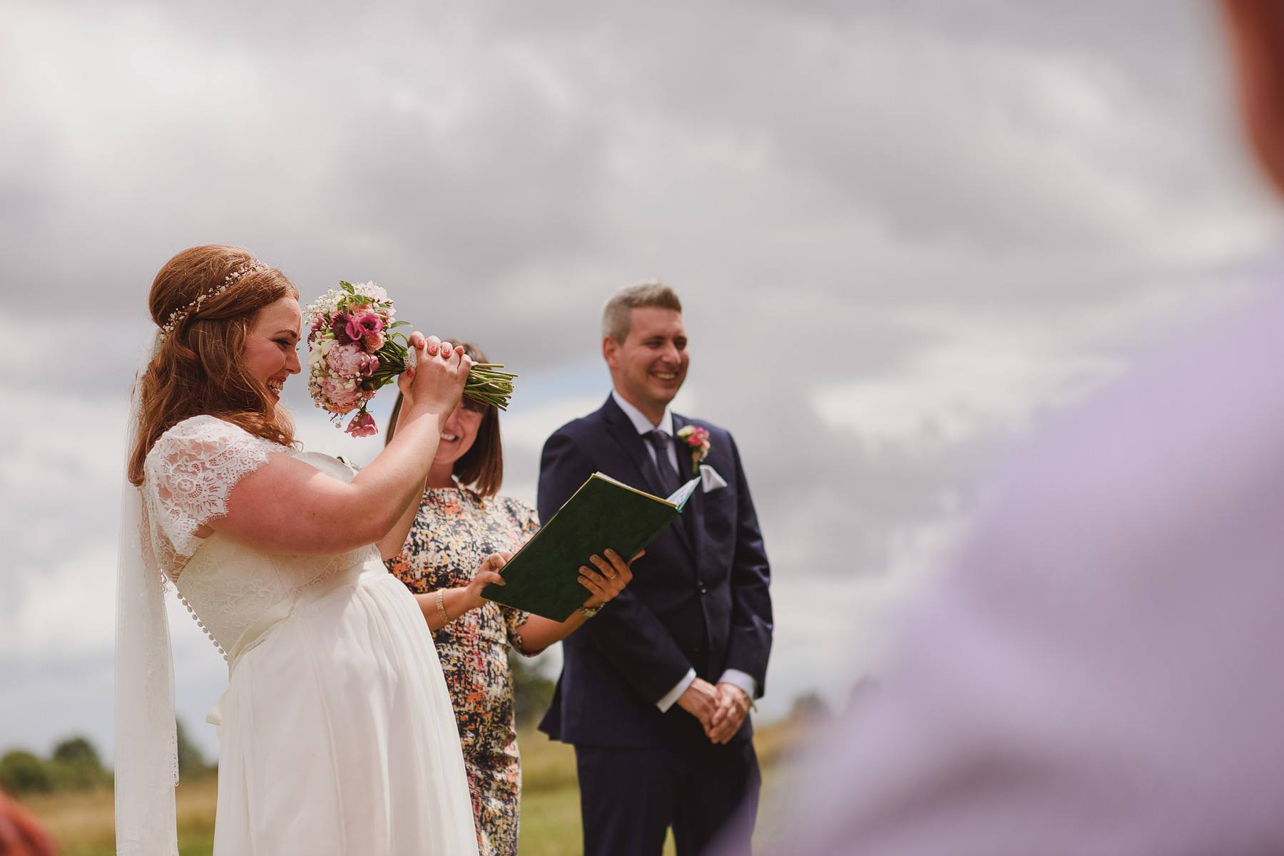 bride laughing during her wedding ceremony at huntstile