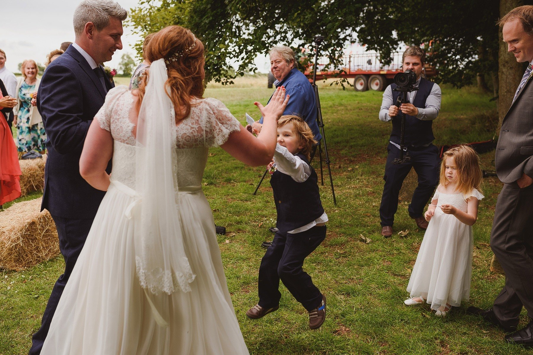 high five after wedding ceremony