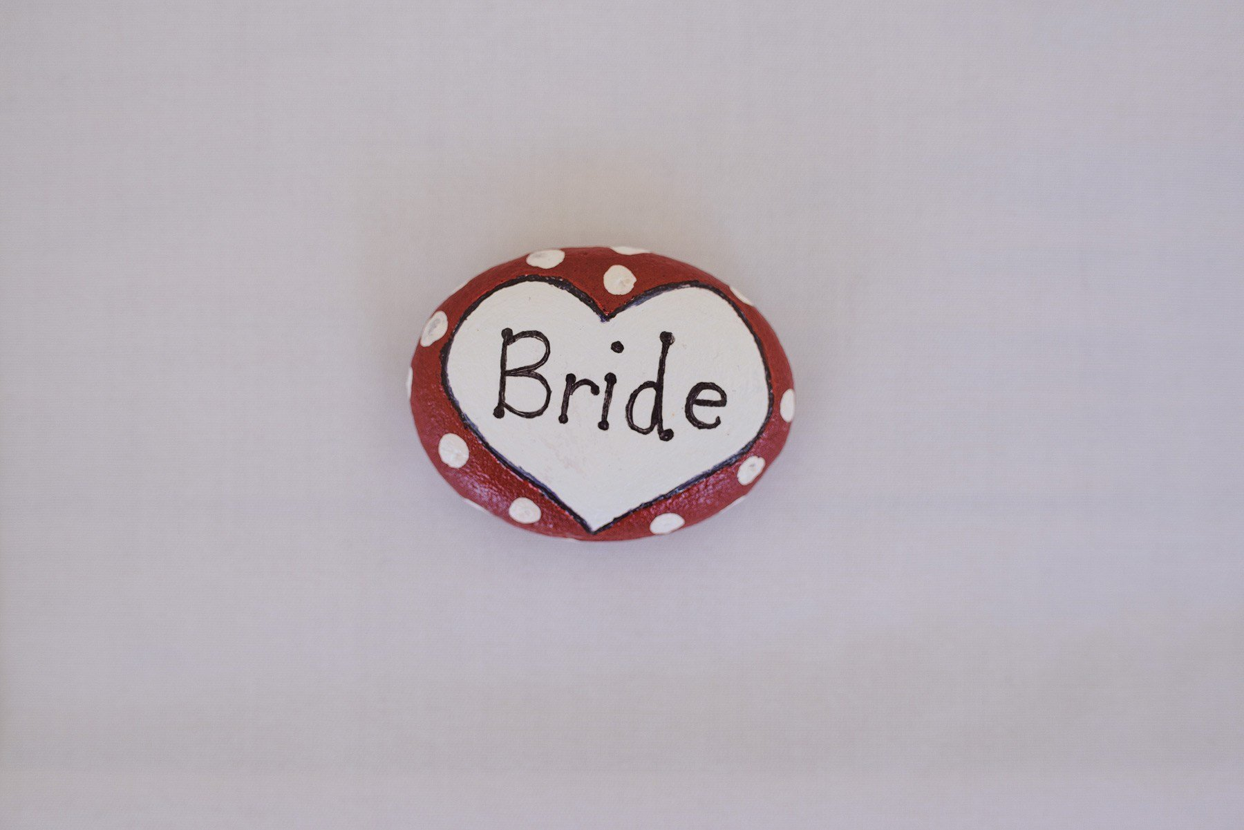 painted pebble place name at wedding