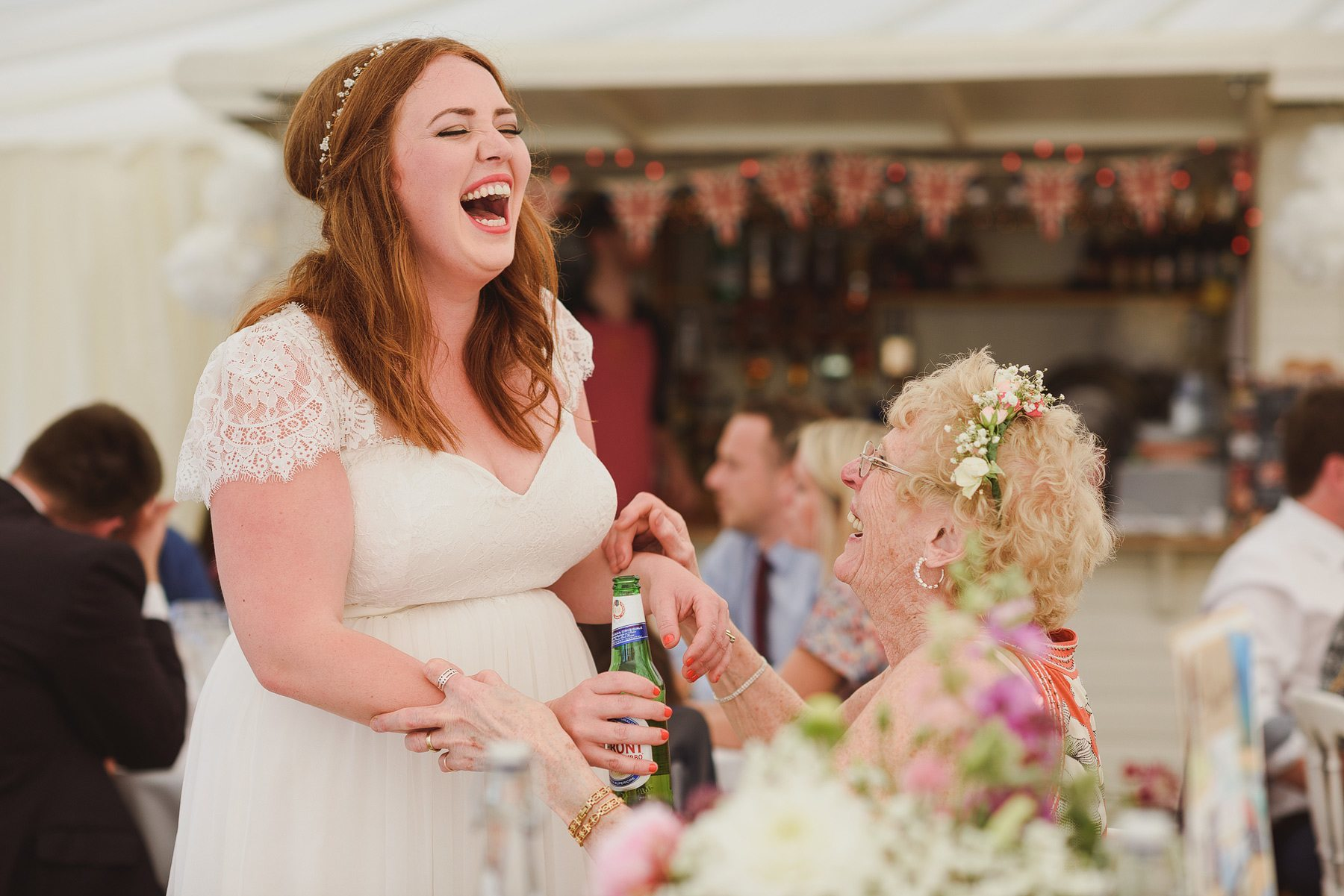 bride and aunt laughing at wedding