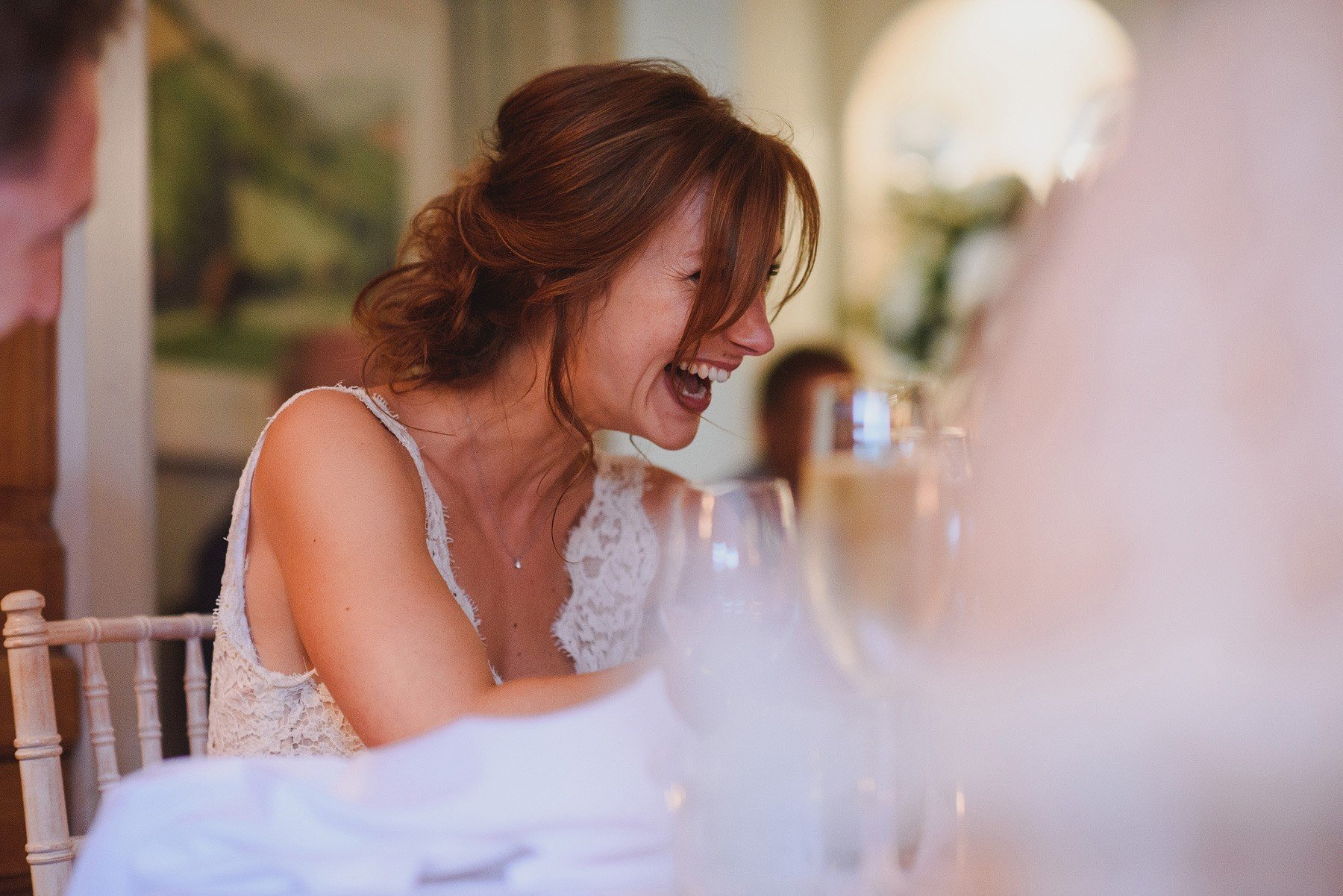 bride laughing at speech at the rectory in crudwell