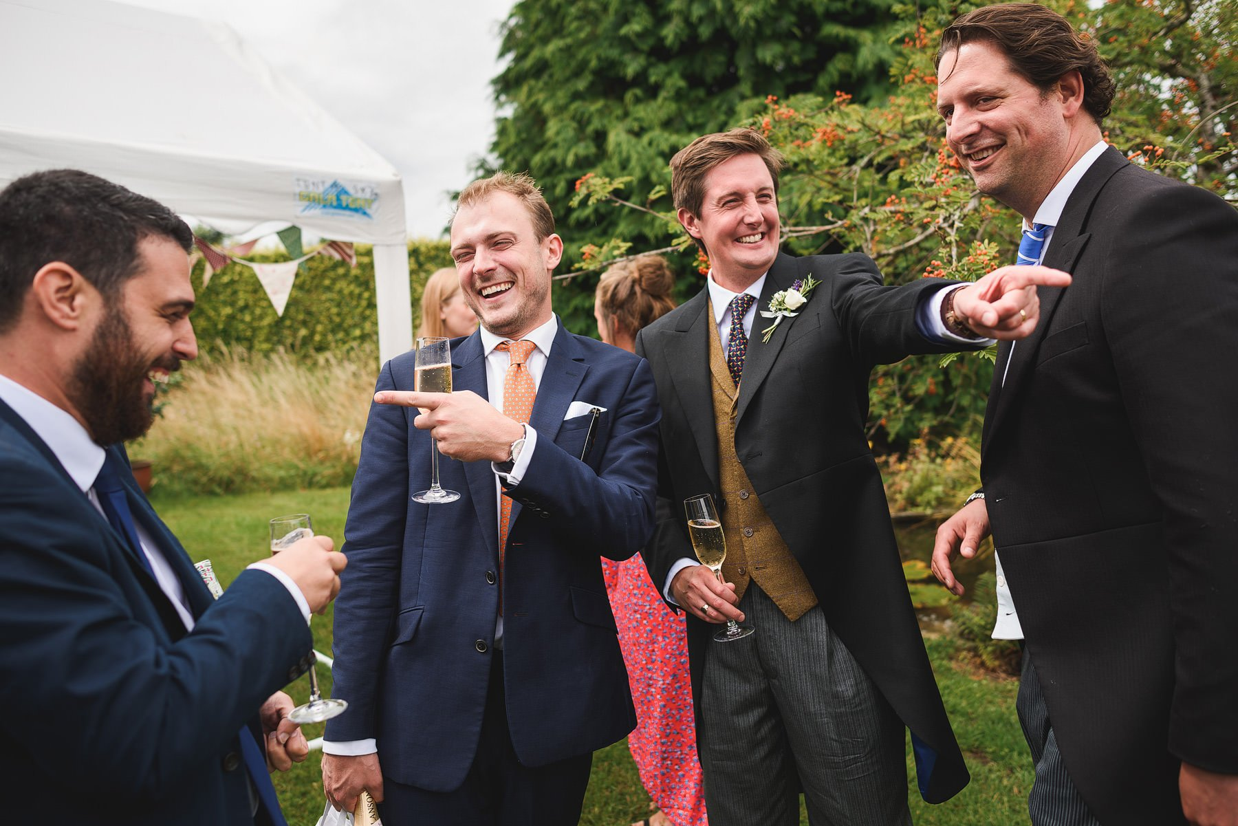 guys laughing at a somerset wedding