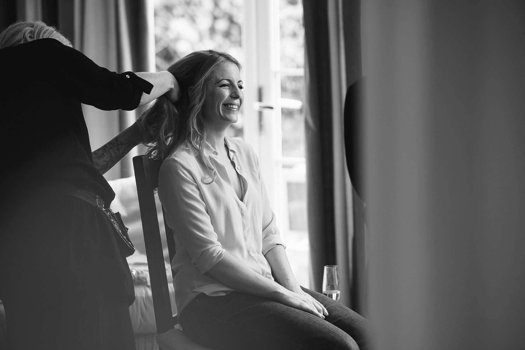 bride smiling while getting ready for her wedding