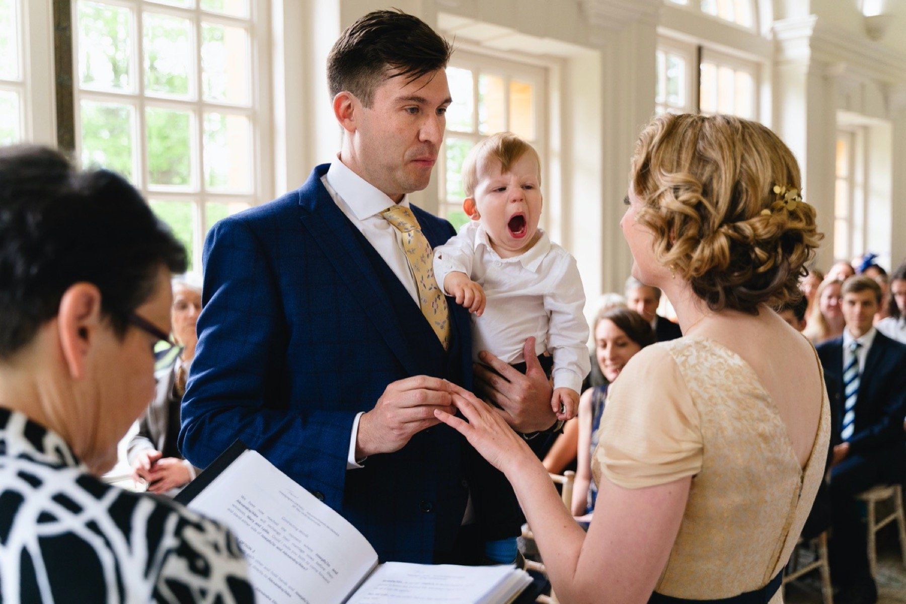 child yawning during wedding at hestercombe gardens