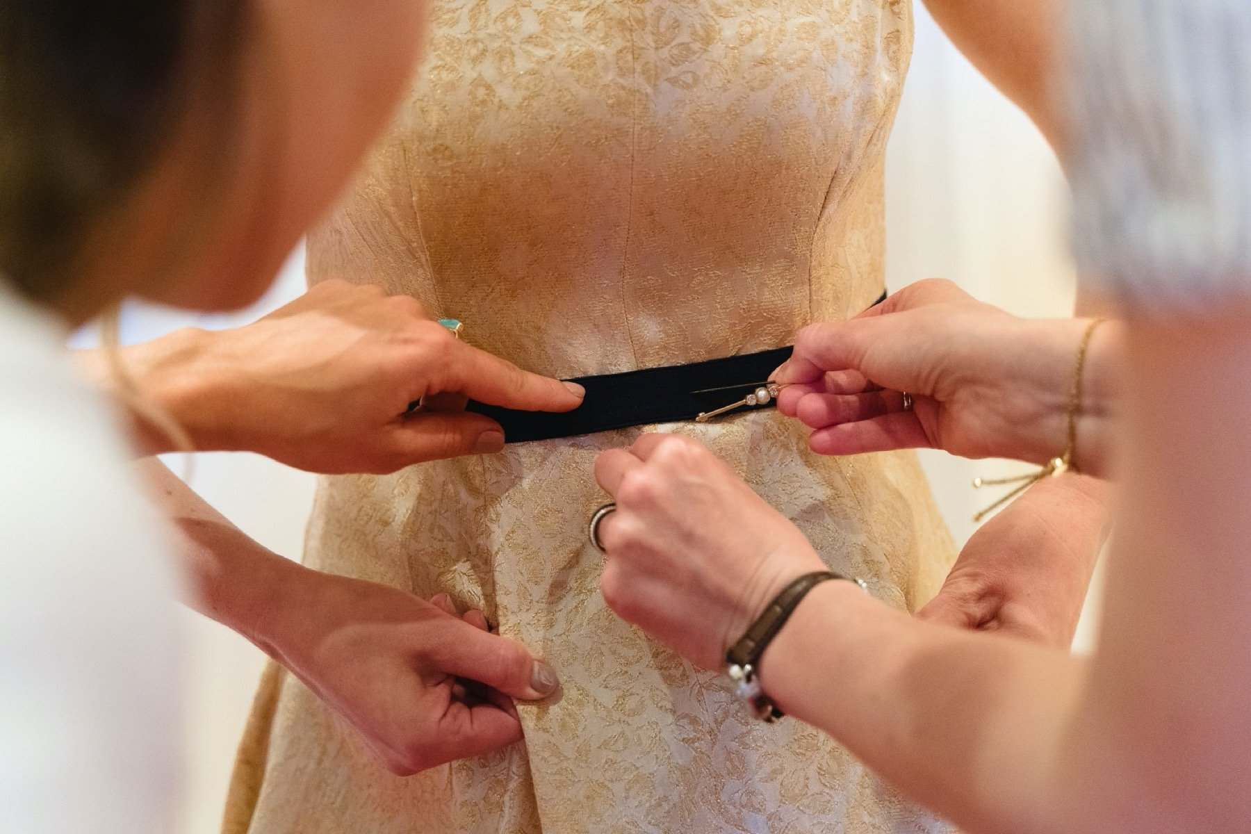 putting on a wedding dress at the castle hotel, taunton